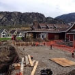 Working on the swimming pool deck behind the clubhouse