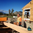 A craftsman working on the heavy timbers for the clubhouse
